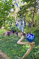 Blue glass bottle garden in shade