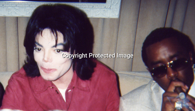 Michael Jackson & Sean P. Diddy Combs.Sean P. Diddy Combs and Ron Burkle Present The Return of Gatsby .2003 MTV Movie Awards Post Party.Ron Burkle Beverly Hills Mansion.Los Angeles, Beverly Hills, CA.Saturday, May 31, 2003.Sales at Celebrityvibe.com/Photovibe.com.