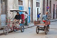 Cuba, Havana.  Three-wheeled Transport.  Bicitaxi Driver Waits for a Customer.