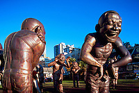 """A-maze-ing Laughter"" Sculpture (artist: Yue Minjun) installed for the 2009 - 2011 Vancouver Biennale Exhibition, Vancouver, BC, British Columbia, Canada - Public Art and Tourist Attraction at Morton Park in the West End near English Bay"
