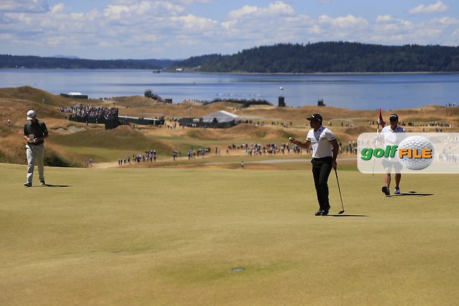 Jason DAY (AUS) sinks his putt on the 7th green during Friday's Round 2 of the 2015 U.S. Open 115th National Championship held at Chambers Bay, Seattle, Washington, USA. 6/19/2015.<br /> Picture: Golffile | Eoin Clarke<br /> <br /> <br /> <br /> <br /> All photo usage must carry mandatory copyright credit (&copy; Golffile | Eoin Clarke)