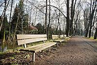 Empty park bench in winter