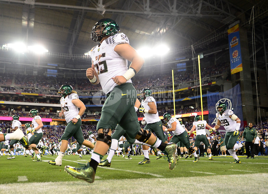 Jan. 3, 2013; Glendale, AZ, USA: Oregon Ducks offensive lineman Hroniss Grasu (55) warms up prior to the game against the Kansas State Wildcats during the 2013 Fiesta Bowl at University of Phoenix Stadium. Oregon defeated Kansas State 35-17. Mandatory Credit: Mark J. Rebilas-
