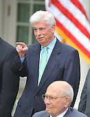 Washington, D.C. - June 22, 2009 -- United States Senator Chris Dodd (Democrat of Connecticut) points to somebody in the audience as U.S. President Barack Obama makes remarks prior to signing the Family Smoking Prevention and Tobacco Control Act in the Rose Garden of the White House on Monday, June 22, 2009.   Looking on is U.S. Representative John Dingell (Democrat of Michigan)..Credit: Ron Sachs - Pool via CNP