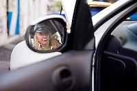 Giuseppe (Bea) della Pelle, fotografato dentro una automobile al lavoro.<br /> Giuseppe della Pelle at work