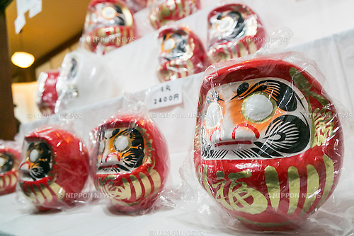 Various Daruma dolls on sale at the Shorinzan Daruma Temple in Takasaki City, Gunma Prefecture on January 6, 2016, Japan. Every year thousands of people visit the country's most famous Daruma market (Daruma ichi) held at the Shorinzan Daruma Temple on January 6 and 7. Takasaki City, is known as the capital of Daruma dolls and about 80% of Japan's Daruma are produced there. According to the tradition, Daruma dolls are sold without pupils painted on their eyes. People color in one pupil when a wish is made or a goal set, and when the wish comes true or the goal is achieved they fill in the other pupil. At the end of the year, used Daruma dolls are returned to the temple to be burned. (Photo by Rodrigo Reyes Marin/AFLO)