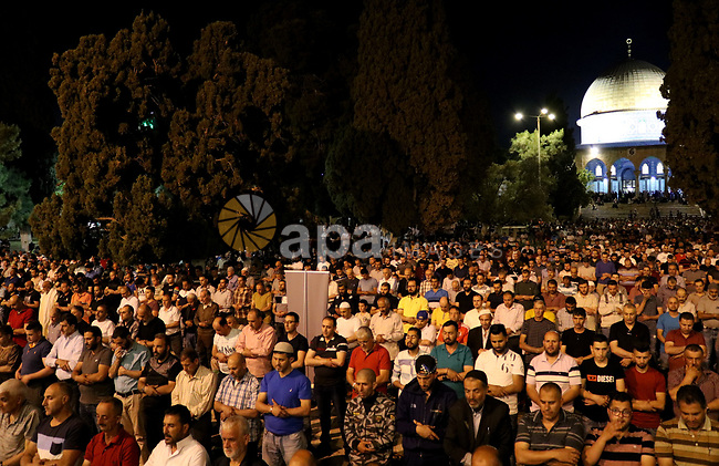 Palestinian Muslim worshipers attend the night prayer known as 'Taraweeh' at al-Aqsa a mosque, during the Muslims holy month of Ramadan, in Jerusalem's Old city on May 16, 2019. Muslims around the world celebrate the holy month of Ramadan by praying during the night time and abstaining from eating, drinking, and sexual acts during the period between sunrise and sunset. Photo by Abdalrahman Alami