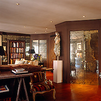 Antique mirrored panels have been used on the doors of the drawing room
