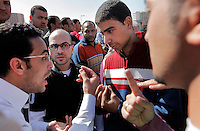 Men discuss politics in Tahrir square, after the revolution that saw president Hosni Mubarak ousted from office. Some protesters still occupied the Tahrir Square until March 9, when they were chased away by armed men,  while life in other parts of the city returned to normal.