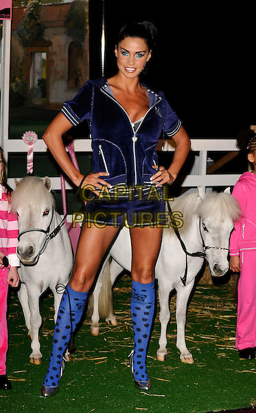 JORDAN - KATIE PRICE.The Spring collection photocall of her equestrian clothing company, the Worx studios, London, England..March 23rd, 2009.full length blue top velvet shorts polka dot socks pony horse purple silver heels shoes hands on hips .CAP/CAN.©Can Nguyen/Capital Pictures.