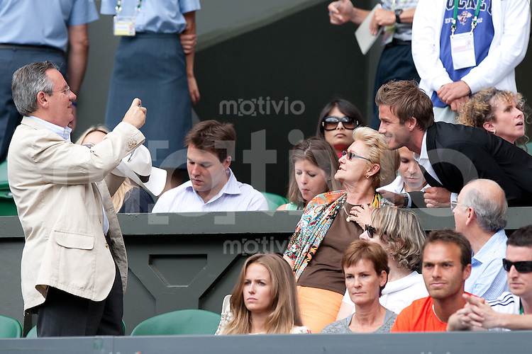 David Beckham poses for pictures with fans during the match of Andy Murray (GBR) against Rafael Nadal (ESP) on Centre Court. The Wimbledon Championships 2010 The All England Lawn Tennis & Croquet Club  Day 11 Friday 02/07/2010