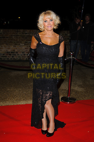 Carol Wright.'The Only Way Is Essex' - live episode - James Argent's Charity Show - Arrivals.Essex, England..3rd December 2012.full length black lace dress belt gloves hand on hip slit split TOWIE.CAP/CJ.©Chris Joseph/Capital Pictures
