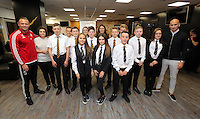 Pictured: Lee Trundle and Jonjo Shelvey pose with pupils Wednesday 25 November 2015<br />