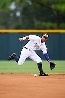 Lakeland Flying Tigers shortstop Anthony Pereira (12) fields a ground ball during a game against the Brevard County Manatees on August 8, 2016 at Henley Field in Lakeland, Florida.  Lakeland defeated Brevard County 6-2.  (Mike Janes/Four Seam Images)