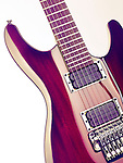 Red Ibanez S-series electric guitar artistic closeup on white background