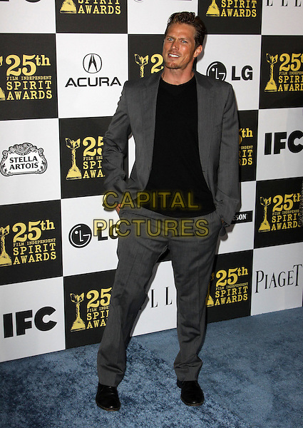 JASON LEWIS .25th Annual Film Independent Spirit Awards held At The Nokia LA Live, Los Angeles, California, USA,.March 5th, 2010 ..arrivals Indie Spirit full length black grey gray suit hands in pockets tanned sun tan .CAP/ADM/KB.©Kevan Brooks/Admedia/Capital Pictures