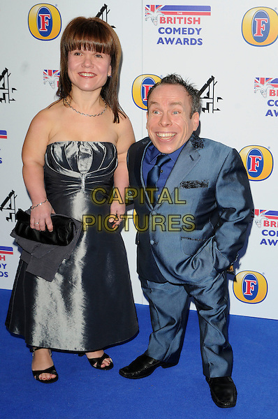 SAMANTHA & WARWICK DAVIS.Attending the British Comedy Awards 2011at Indigo, The O2 Arena, London.England, UK, January 22nd, 2011..arrivals full length blue suit strapless dress wife husband couple clutch bag married tie .CAP/CAN.©Can Nguyen/Capital Pictures.