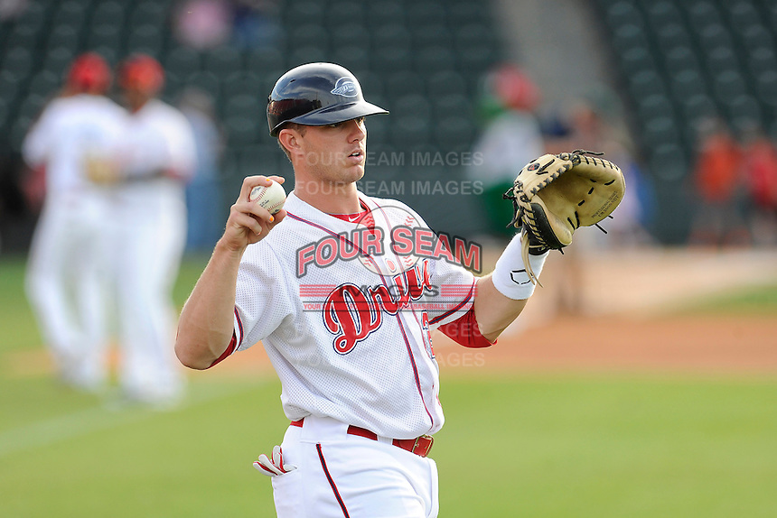 Catcher Ben Moore (25) of the Greenville Drive warms up before a game against the Lexington Legends on Tuesday, April 14, 2015, at Fluor Field at the West End in Greenville, South Carolina. Lexington won, 5-3. (Tom Priddy/Four Seam Images)