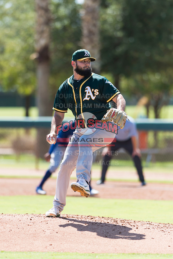 Oakland Athletics relief pitcher Joe DeMers (73) delivers a pitch during an Instructional League game against the Los Angeles Dodgers at Camelback Ranch on September 27, 2018 in Glendale, Arizona. (Zachary Lucy/Four Seam Images)