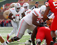 Ohio State Buckeyes quarterback J.T. Barrett (16) hands off to running back Rod Smith (7) for a touchdown run during the first quarter of the NCAA football game at Byrd Stadium in College Park, Maryland on Oct. 4, 2014. (Adam Cairns / The Columbus Dispatch)