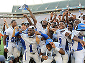 Armwood Hawks, including Garian Brown #1, Gregory Newton #2, Alvin Bailey #3, celebrates their state title after the Florida High School Athletic Association 6A Championship Game at Florida's Citrus Bowl on December 17, 2011 in Orlando, Florida.  Armwood defeated Miami Central 40-31.  (Photo By Mike Janes Photography)