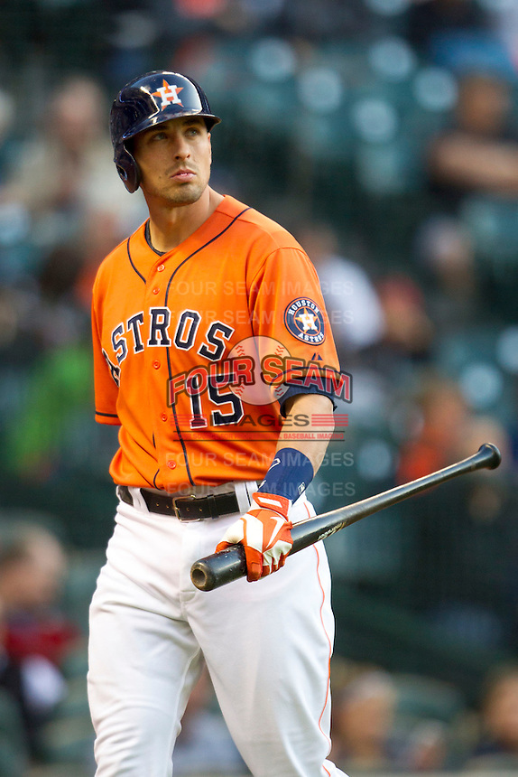 Houston Astros designated hitter Jason Castro (15) walks to the dugout after striking out in the MLB baseball game against the Detroit Tigers on May 3, 2013 at Minute Maid Park in Houston, Texas. Detroit defeated Houston 4-3. (Andrew Woolley/Four Seam Images).
