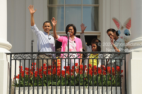 United States President Barack Obama, First Lady Michelle Obama and daughters Sasha and Malia (L to R) wave to guests on the South Lawn during the White House Easter Egg Roll in Washington on Monday, April 5, 2010.   .Credit: Roger L. Wollenberg / Pool via CNP