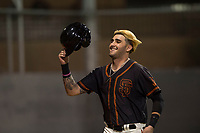 AZL Giants Black designated hitter Frankie Tostado (10) is congratulated by teammates after scoring a run during an Arizona League game against the AZL Angels at the San Francisco Giants Training Complex on July 1, 2018 in Scottsdale, Arizona. The AZL Giants Black defeated the AZL Angels by a score of 4-2. (Zachary Lucy/Four Seam Images)
