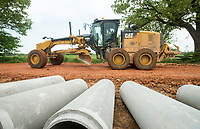 NWA Democrat-Gazette/BEN GOFF @NWABENGOFF<br /> A crew from the Benton County Road Department replaces drainage culverts and grades the road surface Thursday, May 10, 2018, along Accident Road near Springdale.