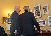 United States Senator Patrick Leahy (Democrat of Vermont), Ranking Member, US Senate Committee on the Judiciary, left, shows some of his photography to Judge Merrick Garland, chief justice for the US Court of Appeals for the District of Columbia Circuit, right, who is US President Barack Obama's selection to replace the late Associate Justice Antonin Scalia on the US Supreme Court, prior to their meeting on Capitol Hill in Washington, DC on Thursday, March 17, 2016.   <br /> Credit: Ron Sachs / CNP