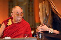 His holiness, the Dalai Lama, left, and television news anchor Maria Shriver greet the audience during the 'Women and Peace-building' discussion, at the Orpheum Theater, Sept. 29, 2009, Vancouver BC. (Scott Alexander/pressphotointl.com)
