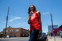 Jun. 10, 2013; Phoenix, AZ, USA: Phoenix Mercury center Brittney Griner leaves the Golden Rule Tattoo shop in downtown Phoenix. Mandatory Credit: Mark J. Rebilas-
