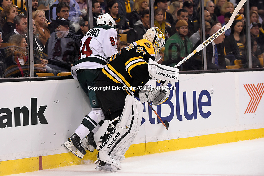 Thursday, November 19, 2015: Boston Bruins goalie Jonas Gustavsson (50) checks Minnesota Wild center Mikael Granlund (64) behind the net during the National Hockey League game between the Minnesota Wild and the Boston Bruins held at TD Garden, in Boston, Massachusetts. The Bruins defeat the Wild 4-2. Eric Canha/CSM