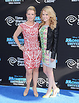 Melissa Joan Hart and Taylor Spreitler <br />  at The Disney-Pixar's World Premiere of Monsters University held at El Capitan Theatre in Hollywood, California on June 17,2013                                                                   Copyright 2013 Hollywood Press Agency