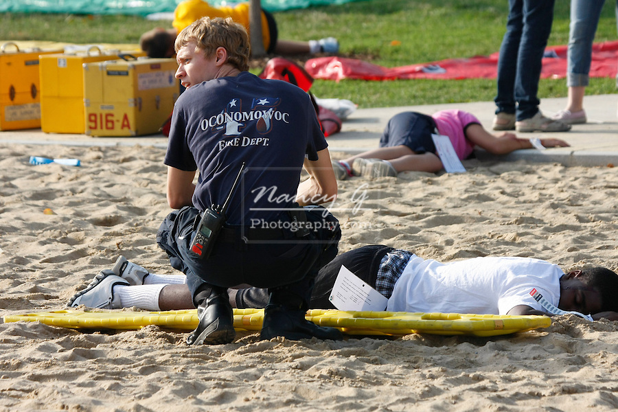 An EMT at a scene of a mass casulty exercise helping on one of the victims