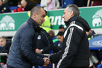 Swansea City Head Coach Francesco Guidolin shakes hands with Everton Manager Roberto Martinez ahead of the Barclays Premier League match between Everton and Swansea City played at Goodison Park, Liverpool
