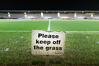 3rd December 2019; Pirelli Stadium, Burton Upon Trent, Staffordshire, England; English League One Football, Burton Albion versus Southend United; A Please Keep Off The Grass sign on pitch side before the match - Strictly Editorial Use Only. No use with unauthorized audio, video, data, fixture lists, club/league logos or 'live' services. Online in-match use limited to 120 images, no video emulation. No use in betting, games or single club/league/player publications
