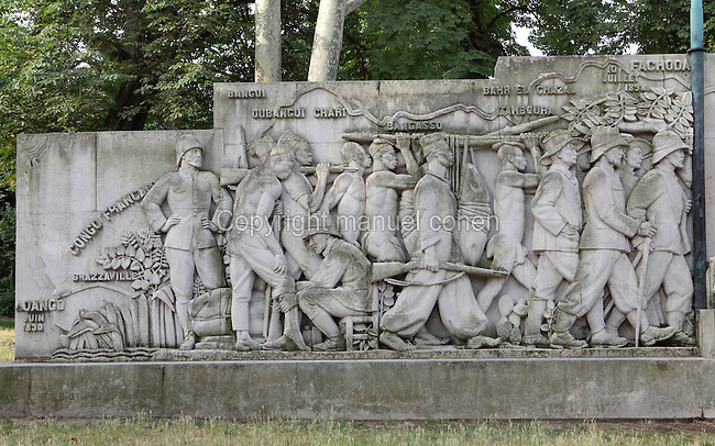 Monument a la gloire de la colonisation (Monument to the Glory of Colonisation), erected for the Paris Colonial Exhibition at the Bois de Vincennes in 1931, at Porte Doree, Paris, France. This stone relief, depicting French and colonial soldiers, was commissioned in memory of Jean-Baptiste Marchand, 1863-1934, who led a mission from the Congo to the Nile, to expand French territory in Africa by taking it from the British. Along with 250 Senegalese soldiers, he reached Fachoda in Sudan before abandoning the expedition in 1897. Several remnants of the Colonial Exhibition remain in and around the Bois de Vincennes to this day. Picture by Manuel Cohen