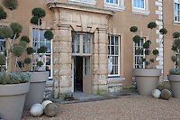 The imposing entrance to Aynhoe Park is matched only by the oversized planters on either side of the doorway