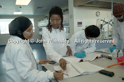Staff member working with students in the superlab in the Science Centre, London Metropolitan University, where 280 students can each work independently.