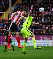 Lincoln City's Luke Waterfall vies for possession with York City's Shaun Rooney<br /> <br /> Photographer Andrew Vaughan/CameraSport<br /> <br /> Buildbase FA Trophy Semi Final Second Leg - Lincoln City v York City - Saturday 18th March 2017 - Sincil Bank - Lincoln<br />  <br /> World Copyright &copy; 2017 CameraSport. All rights reserved. 43 Linden Ave. Countesthorpe. Leicester. England. LE8 5PG - Tel: +44 (0) 116 277 4147 - admin@camerasport.com - www.camerasport.com