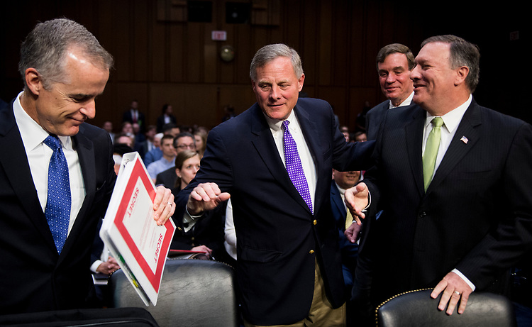 "UNITED STATES - MAY 11: From left, Acting FBI Director Andrew McCabe, chairman Sen. Richard Burr, R-N.C., Sen. Mark Warner, D-Va., and CIA Director Mike Pompeo greet each other before the start of the Senate (Select) Intelligence Committee hearing on ""World Wide Threats"" on Thursday, May 11, 2017. (Photo By Bill Clark/CQ Roll Call)"