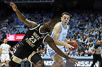 CHAPEL HILL, NC - MARCH 03: Justin Pierce #32 of the University of North Carolina side steps Chaundree Brown #23 of Wake Forest University during a game between Wake Forest and North Carolina at Dean E. Smith Center on March 03, 2020 in Chapel Hill, North Carolina.