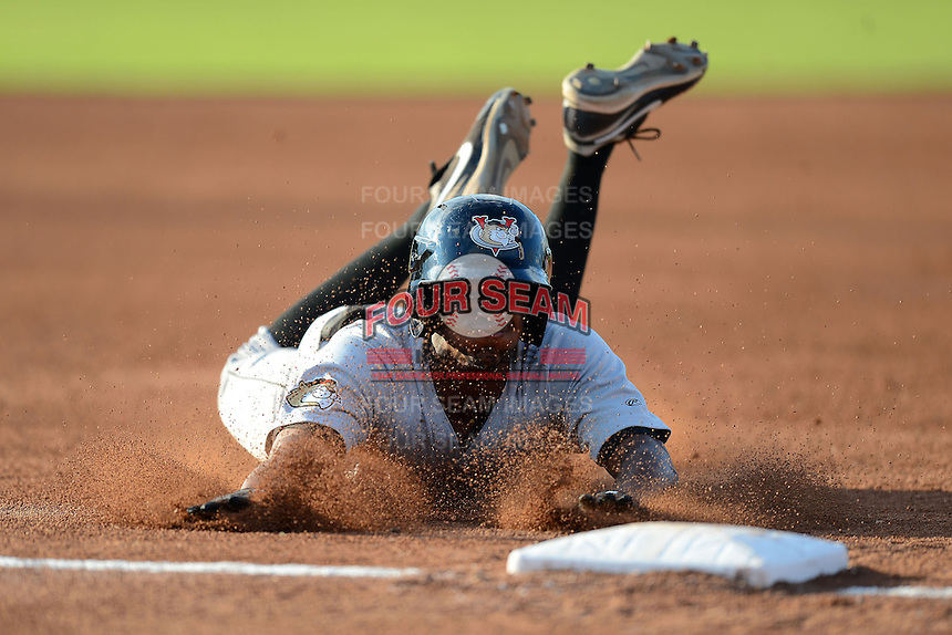 Tri-City ValleyCats outfielder Ronnie Mitchell (12) dives into third during a game against the Batavia Muckdogs on July 13, 2013 at Dwyer Stadium in Batavia, New York.  Tri-City defeated Batavia 5-4.  (Mike Janes/Four Seam Images)