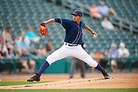 Northwest Arkansas Naturals starting pitcher Emilio Ogando (23) delivers a pitch during a game against the Midland RockHounds on May 27, 2017 at Arvest Ballpark in Springdale, Arkansas.  NW Arkansas defeated Midland 3-2.  (Mike Janes/Four Seam Images)