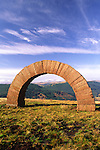 Andy Goldsworthy's Striding Arches sculptures on Bail Hill looking across to the mist cover Glenkens hills Dumfries and Galloway Scotland UK