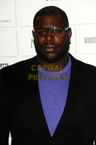 Steve McQueen.The 14th Moet British Independent Film Awards 2011, Old Billingsgate, London, England..December 4th, 2011.half length black jacket purple top glasses beard facial hair .CAP/CJ.©Chris Joseph/Capital Pictures.