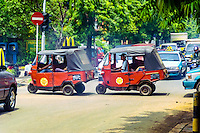 Java, Jakarta. Two Bajaj in Kemang Raya. An auto rickshaw is generally characterized by a sheet-metal body or open frame resting on three wheels.