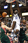 Dallas Mavericks' Brandon Bass dunks over Milwaukee Bucks' Andrew Bogut, left, and Charlie Villanueva in the second half of an NBA basketball game in Dallas on Wednesday, February 6, 2008.  (photo by Khampha Bouaphanh)