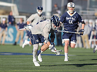 Washington, DC - February 27, 2018: Georgetown Hoyas Peter Tagliaferri (2) scoops the ball off the ground during game between Mount St. Mary's and Georgetown at  Cooper Field in Washington, DC.   (Photo by Elliott Brown/Media Images International)